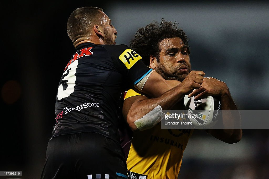 <a gi-track='captionPersonalityLinkClicked' href=/galleries/search?phrase=Sam+Thaiday&family=editorial&specificpeople=540245 ng-click='$event.stopPropagation()'>Sam Thaiday</a> of the Broncos is tackled by Lewis Brown of the Panthers during the round 24 NRL match between the Penrith Panthers and the Brisbane Broncos at Centrebet Stadium on August 23, 2013 in Sydney, Australia.