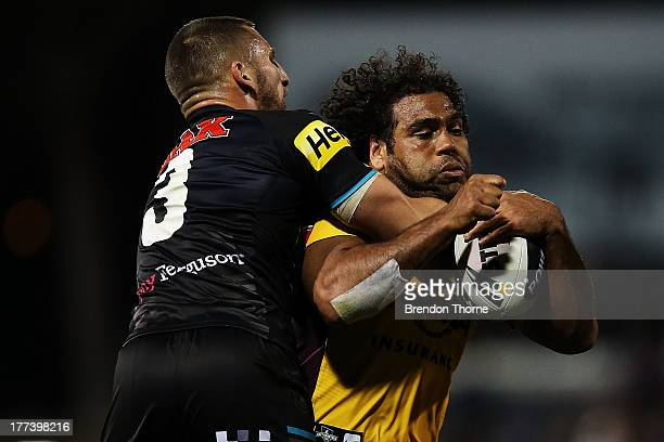 Sam Thaiday of the Broncos is tackled by Lewis Brown of the Panthers during the round 24 NRL match between the Penrith Panthers and the Brisbane...