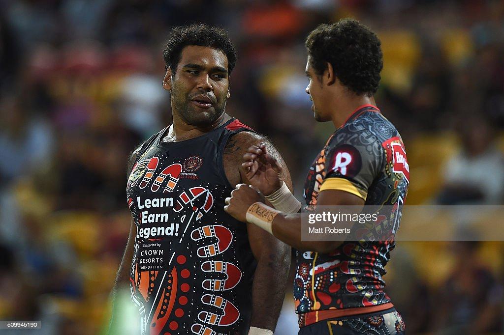 Sam Thaiday of the Indigenous All Stars speaks with Dane Gagai before the NRL match between the Indigenous All-Stars and the World All-Stars at Suncorp Stadium on February 13, 2016 in Brisbane, Australia.