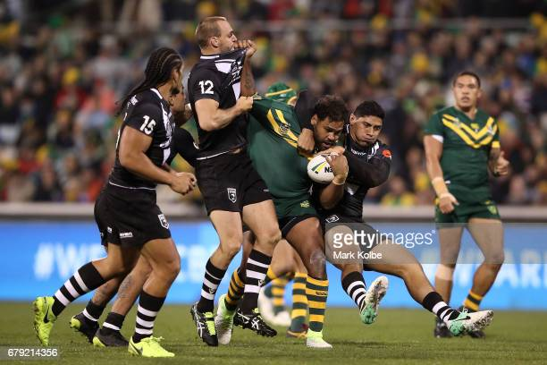 Sam Thaiday of the Kangaroos is tackled by Simon Mannering and Jason Taumalolo of the Kiwis during the ANZAC Test match between the Australian...