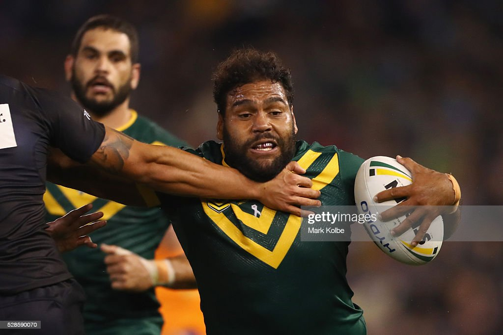 <a gi-track='captionPersonalityLinkClicked' href=/galleries/search?phrase=Sam+Thaiday&family=editorial&specificpeople=540245 ng-click='$event.stopPropagation()'>Sam Thaiday</a> of the Kangaroos is tackled during the International Rugby League Trans Tasman Test match between the Australian Kangaroos and the New Zealand Kiwis at Hunter Stadium on May 6, 2016 in Newcastle, Australia.
