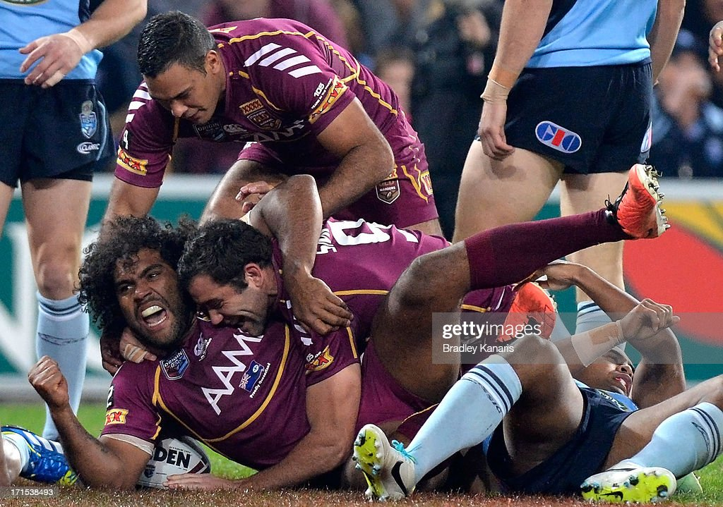 <a gi-track='captionPersonalityLinkClicked' href=/galleries/search?phrase=Sam+Thaiday&family=editorial&specificpeople=540245 ng-click='$event.stopPropagation()'>Sam Thaiday</a> of the Maroons celebrates after scoring a try during game two of the ARL State of Origin series between the Queensland Maroons and the New South Wales Blues at Suncorp Stadium on June 26, 2013 in Brisbane, Australia.