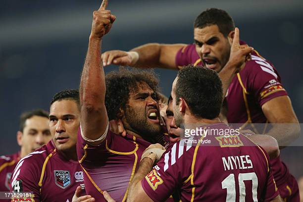 Sam Thaiday of the Maroons celebrates with team mates after scoring a try during game two of the ARL State of Origin series between the Queensland...