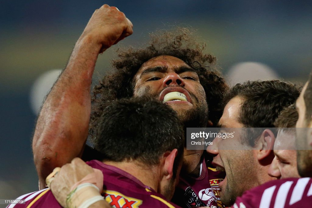 <a gi-track='captionPersonalityLinkClicked' href=/galleries/search?phrase=Sam+Thaiday&family=editorial&specificpeople=540245 ng-click='$event.stopPropagation()'>Sam Thaiday</a> of the Maroons celebrates with team mates after scoring a try during game two of the ARL State of Origin series between the Queensland Maroons and the New South Wales Blues at Suncorp Stadium on June 26, 2013 in Brisbane, Australia.