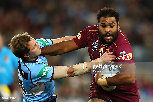 Sam Thaiday of the Maroons fends Matt Moylan of the Blues during game three of the State Of Origin series between the New South Wales Blues and the...