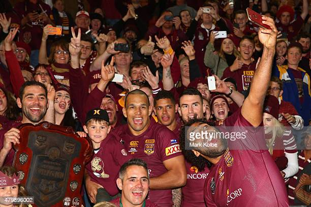 Sam Thaiday of the Maroons takes a selfie as the Maroons pose for a team photo during game three of the State of Origin series between the Queensland...