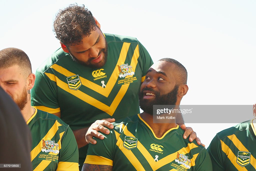 Sam Thaiday speaks to Semi Radradra as the prepare for the team photo during the Australia Kangaroos Test team photo session at Crowne Plaza Coogee on May 2, 2016 in Sydney, Australia.