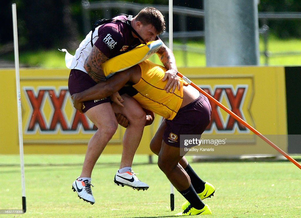 <a gi-track='captionPersonalityLinkClicked' href=/galleries/search?phrase=Sam+Thaiday&family=editorial&specificpeople=540245 ng-click='$event.stopPropagation()'>Sam Thaiday</a> tackles team mate Josh McGuire during a Brisbane Broncos NRL training session on March 7, 2013 in Brisbane, Australia.