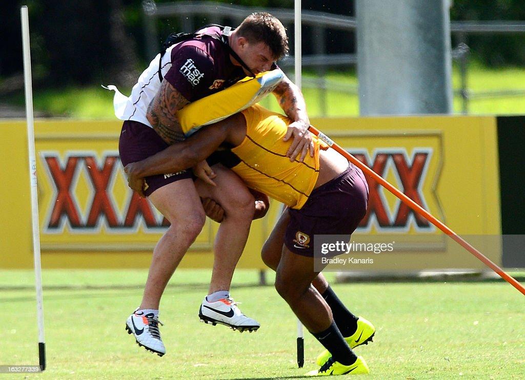 Sam Thaiday tackles team mate Josh McGuire during a Brisbane Broncos NRL training session on March 7, 2013 in Brisbane, Australia.