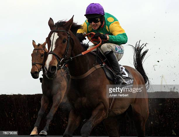 Sam Thomas and Kauto Star clear the last fence to land The Betfair Steeple Chase Race run at Haydock Racecourse on November 24 in Haydock England
