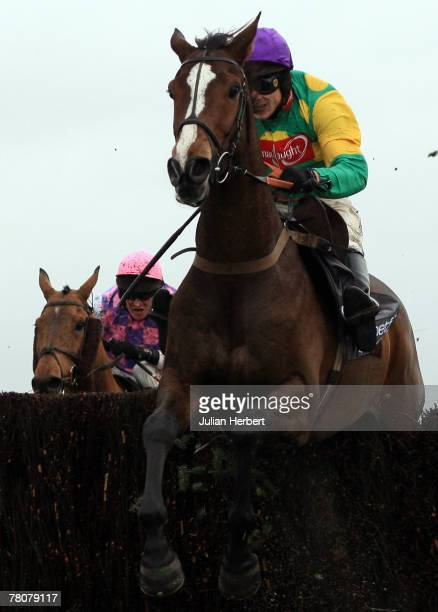 Sam Thomas and Kauto Star clear the last fence to land The Betfair Steeple Chase Race run at Haydock Racecourse on November 24 2007 in Haydock England