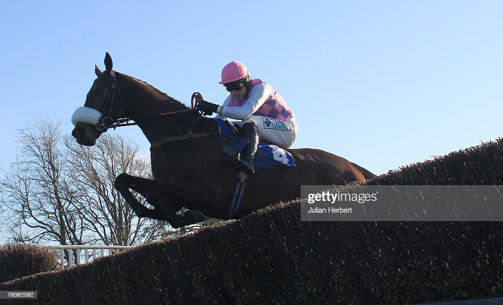 Sam Thomas and O' Malley clear an early fence before landing The Wellpool building And Maintenance Beginners' Steeple Chase Race run at Fontwell Racecourse on December 11, 2007, in Fontwell, England.