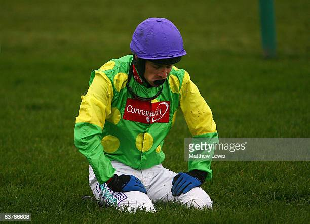 Sam Thomas jockey of Kauto Star looks on after falling at the last fence in the Betfair Steeple Chase Race at Haydock Park Racecourse on November 22...
