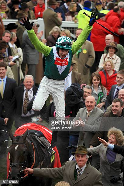 Sam Thomas leaps from Denman after landing The totesport Cheltenham Gold Cup Steeple Chase Race run at Cheltenham Racecourse on March 14 in...