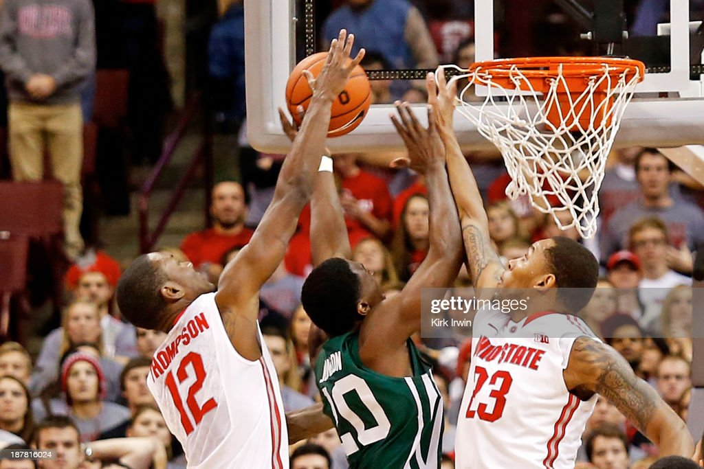 Sam Thompson #12 and Amir Williams #23 of the Ohio State Buckeyes go up for a rebound against Ricardo Johnson #20 of the Ohio Bobcats during the second half at Value City Arena on November 12, 2013 in Columbus, Ohio. Ohio State defeated Ohio 79-69.