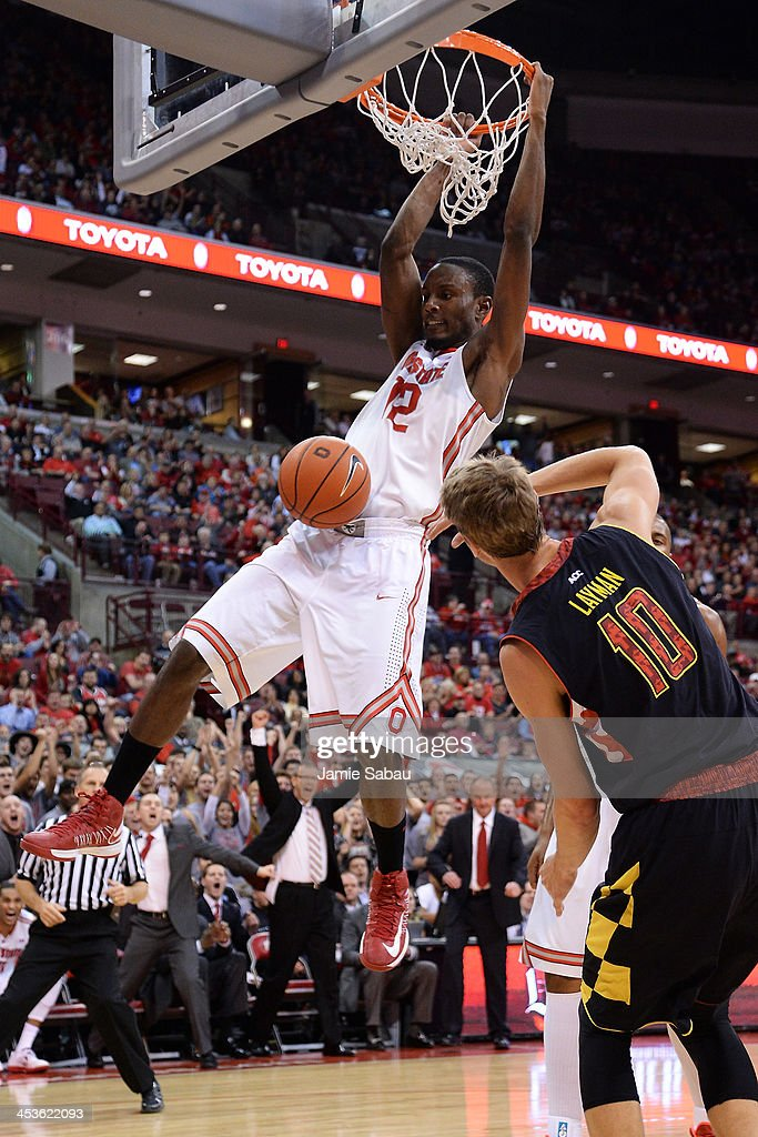 Sam Thompson #12 of the Ohio State Buckeyes completes a fast break with a slam dunk in the second half over Jake Layman #10 of the Maryland Terrapins on December 4, 2013 at Value City Arena in Columbus, Ohio. Ohio State defeated Maryland 76-60.