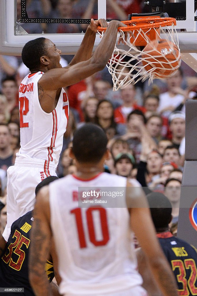 Sam Thompson #12 of the Ohio State Buckeyes completes a fast break with a slam dunk in the first half against the Maryland Terrapins on December 4, 2013 at Value City Arena in Columbus, Ohio. Ohio State defeated Maryland 76-60.