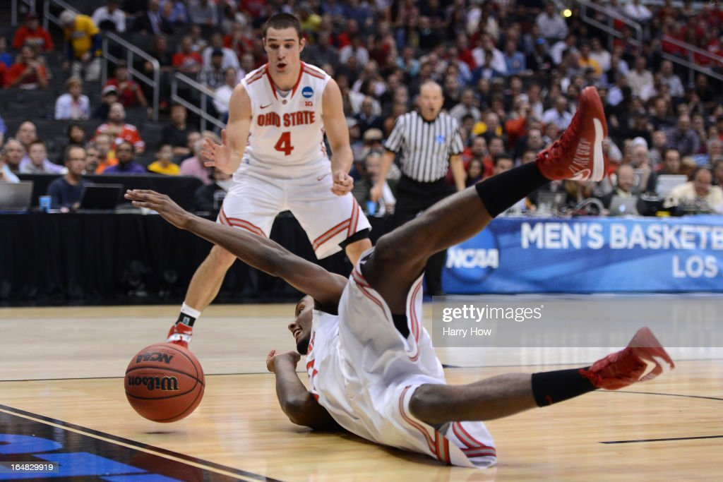 Sam Thompson #12 of the Ohio State Buckeyes dives for a loose ball next to teammate <a gi-track='captionPersonalityLinkClicked' href=/galleries/search?phrase=Aaron+Craft&family=editorial&specificpeople=7348782 ng-click='$event.stopPropagation()'>Aaron Craft</a> #4 in the first half against the Arizona Wildcats during the West Regional of the 2013 NCAA Men's Basketball Tournament at Staples Center on March 28, 2013 in Los Angeles, California.