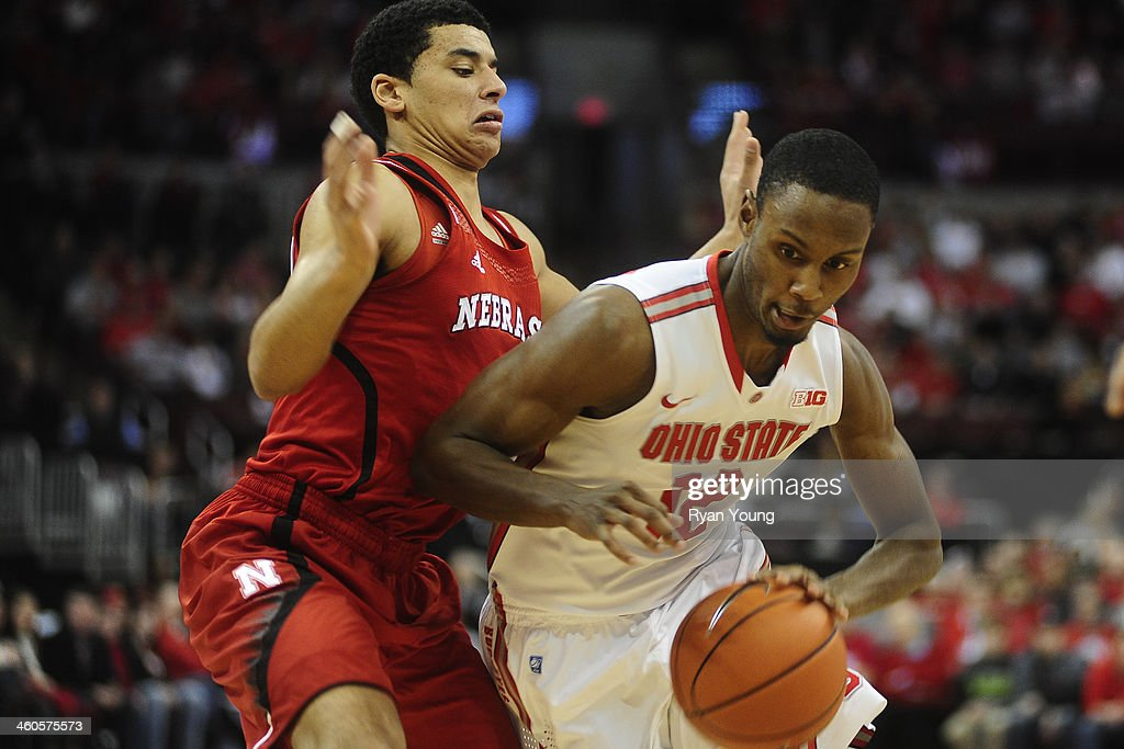 Sam Thompson of the Ohio State Buckeyes dribbles past Benny Parker of the Nebraska Cornhuskers on January 4 20114 at Value City Arena in Columbus...