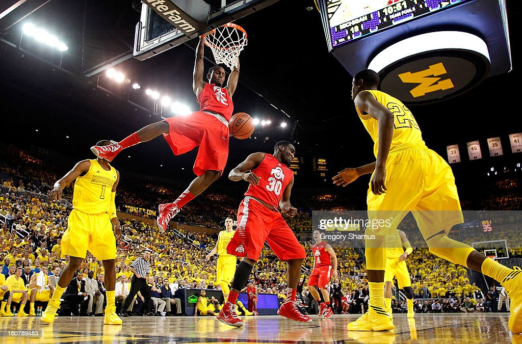 Sam Thompson #12 of the Ohio State Buckeyes gets in for a second half dunk in front of Glenn Robinson III #1 of the Michigan Wolverines at Crisler Center on February 5, 2013 in Ann Arbor, Michigan. Michigan won the game 76-74 in overtime.