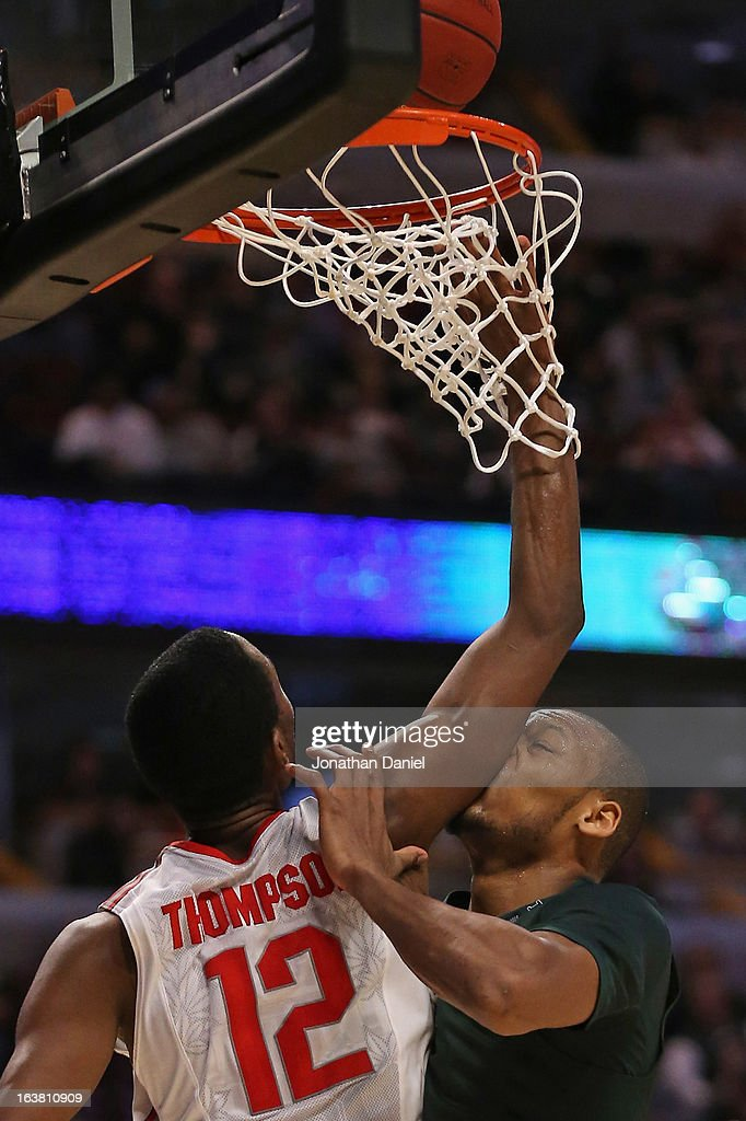 Sam Thompson #12 of the Ohio State Buckeyes goes up for a rebound against Adreian Payne #5 of the Michigan State Spartans during a semifinal game of the Big Ten Basketball Tournament at the United Center on March 16, 2013 in Chicago, Illinois.