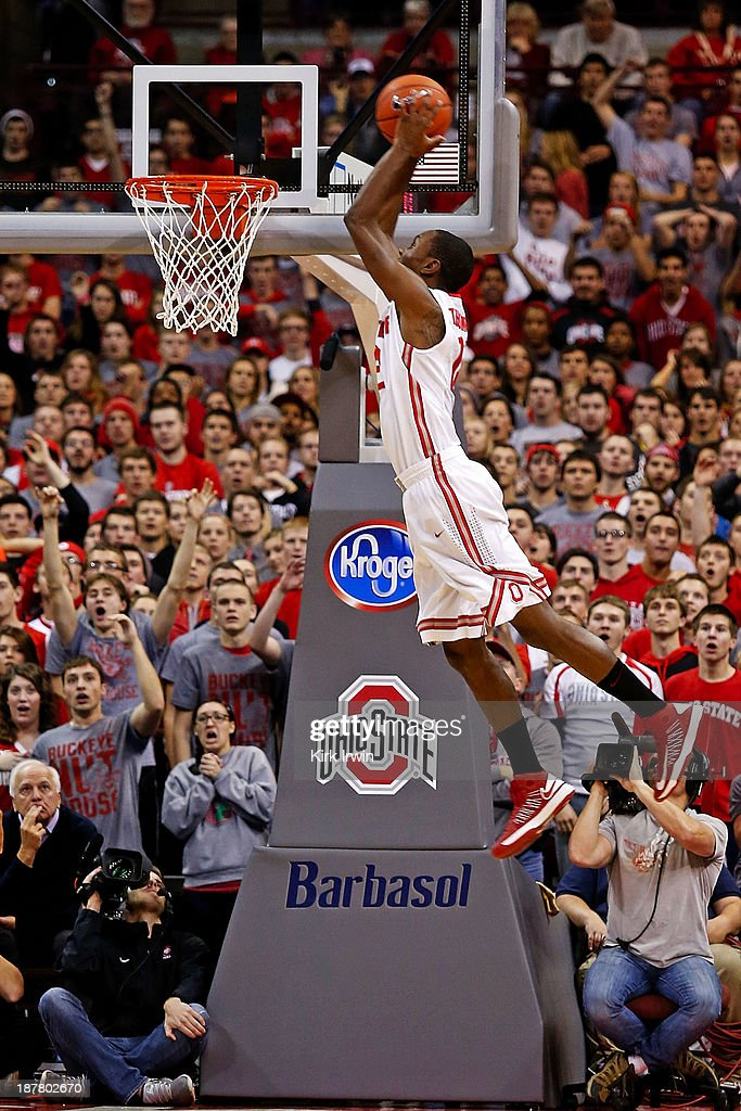 Sam Thompson #12 of the Ohio State Buckeyes goes up for an alley-oop on a pass from Aaron Craft (not pictured) for the dunk during the first half against the Ohio Bobcats at Value City Arena on November 12, 2013 in Columbus, Ohio.