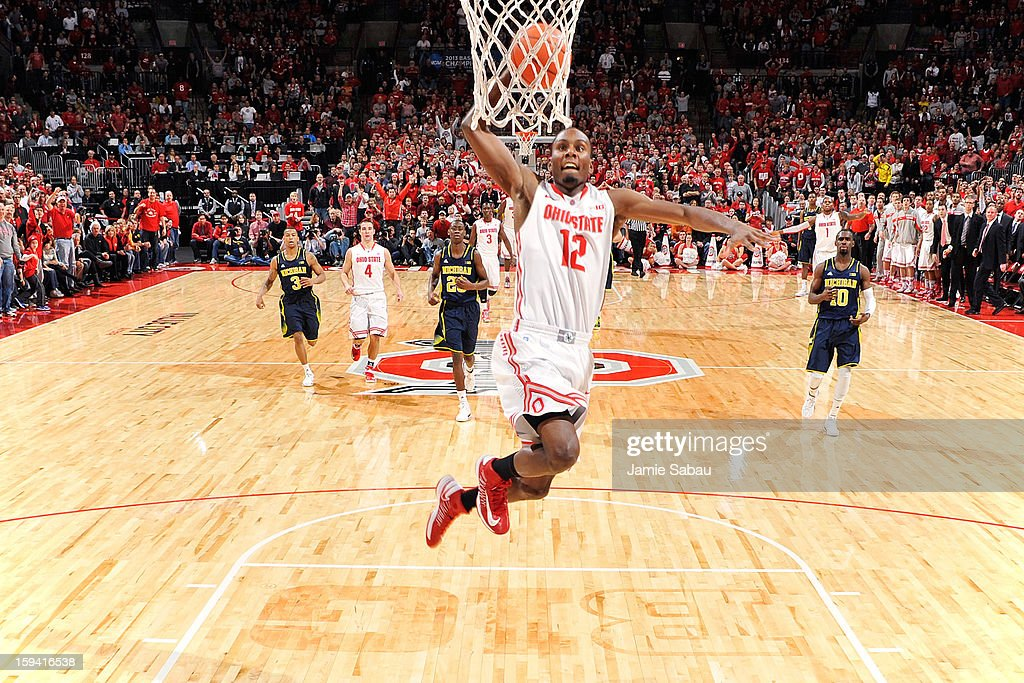 Sam Thompson #12 of the Ohio State Buckeyes sails in for a slam dunk after stealing the ball from the Michigan Wolverines in the first half on January 13, 2013 at Value City Arena in Columbus, Ohio. Ohio State defeated Michigan 56-53.