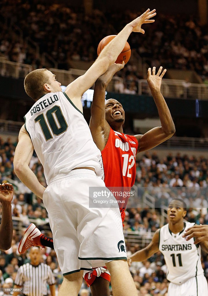 Sam Thompson #12 of the Ohio State Buckeyes shoots against Matt Costello #10 of the Michigan State Spartans in the second half at the Jack Breslin Center on January 19, 2013 in East Lansing, Michigan. Michigan State won the game 59-56.