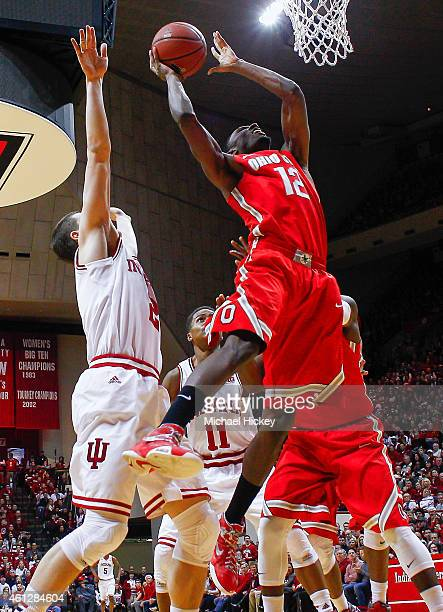 Sam Thompson of the Ohio State Buckeyes shoots the ball as Nick Zeisloft of the Indiana Hoosiers defends at Assembly Hall on January 10 2015 in...