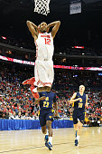 Sam Thompson of the Ohio State Buckeyes slam dunks off a fast break in the second half against the North Carolina AT Aggies on December 17 2014 at...