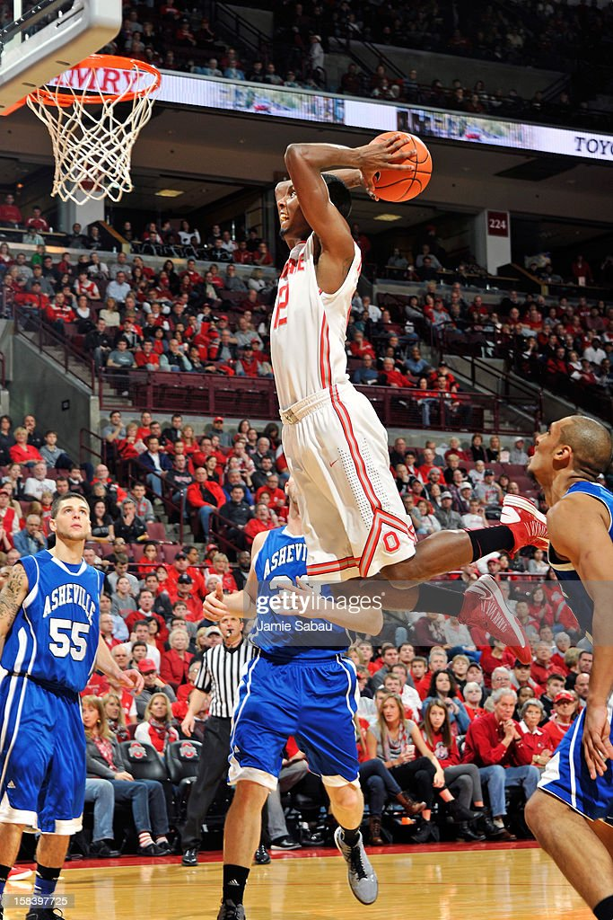 Sam Thompson #12 of the Ohio State Buckeyes soars in for a slam dunk in the first half against the UNC Asheville Bulldogs on December 15, 2012 at Value City Arena in Columbus, Ohio. Ohio State defeated UNC Asheville 90-72.