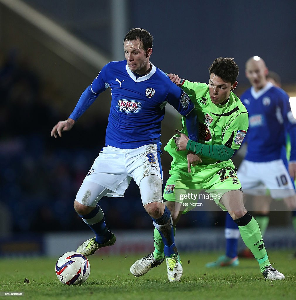 Sam Togwell of Chesterfield controls the ball under pressure from Lewis Hornby of Northampton Town during the npower League Two match between Chesterfield and Northampton Town at the Proact Srtadium on January 12, 2013 in Chesterfield, England.