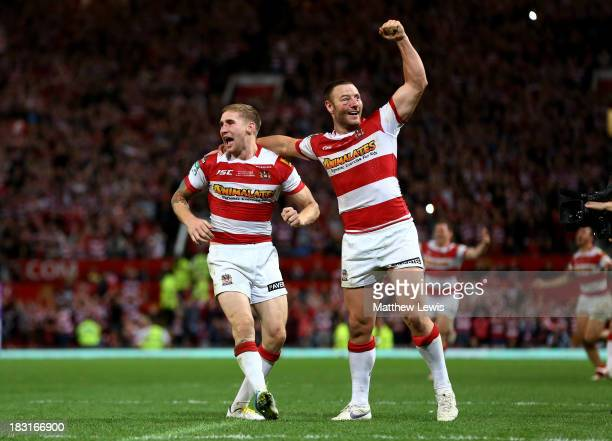 Sam Tomkins and Blake Green of Wigan celebrate their team's 3016 victory during the Super League Grand Final between Warrington Wolves and Wigan...
