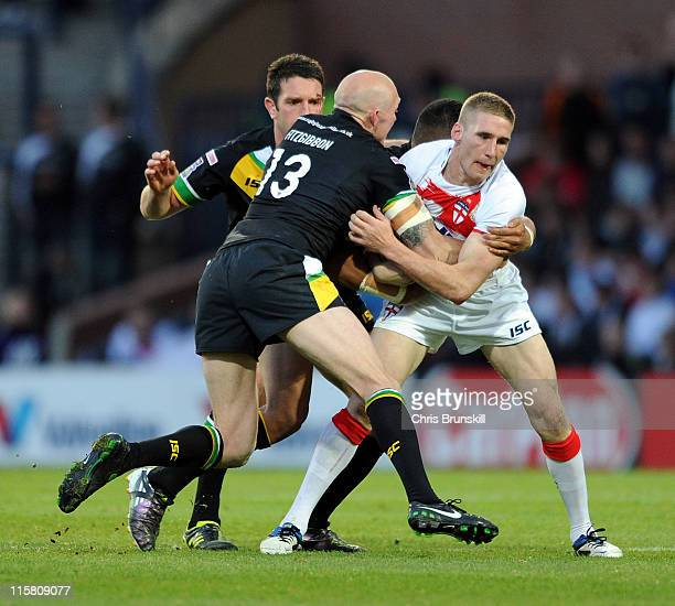 Sam Tomkins of England is tackled by Craig Fitzgibbon of Exiles during the International Origin match between England and Exiles at Headingley...
