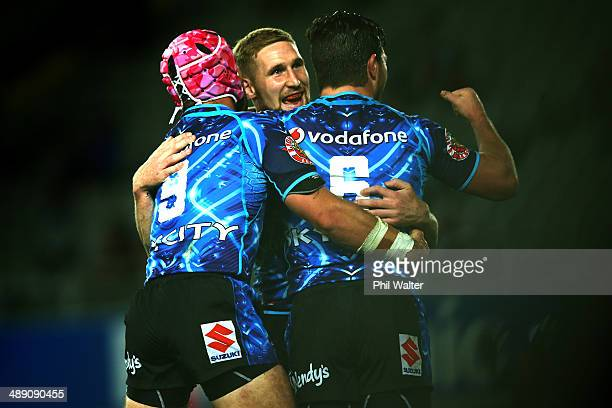 Sam Tomkins of the Warriors celebrates his try during the round nine NRL match between the New Zealand Warriors and the Canberra Raiders at Eden Park...