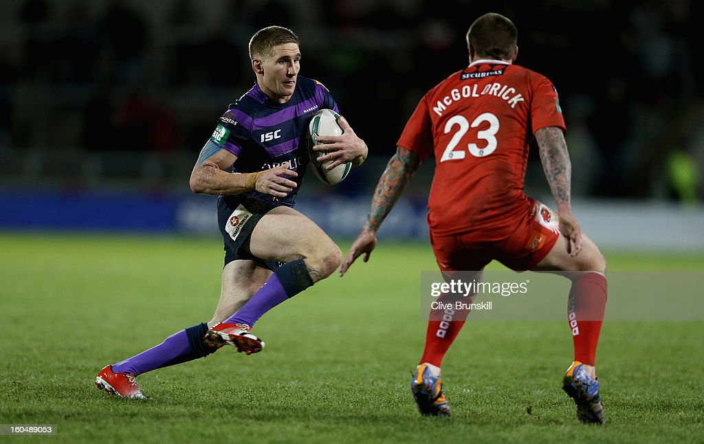 Sam Tomkins of Wigan Warriors attempts to move past Ryan McGoldrick of Salford City Reds during the Super League match between Salford City Reds and Wigan Warriors at Salford City Stadium on February 1, 2013 in Salford, England.