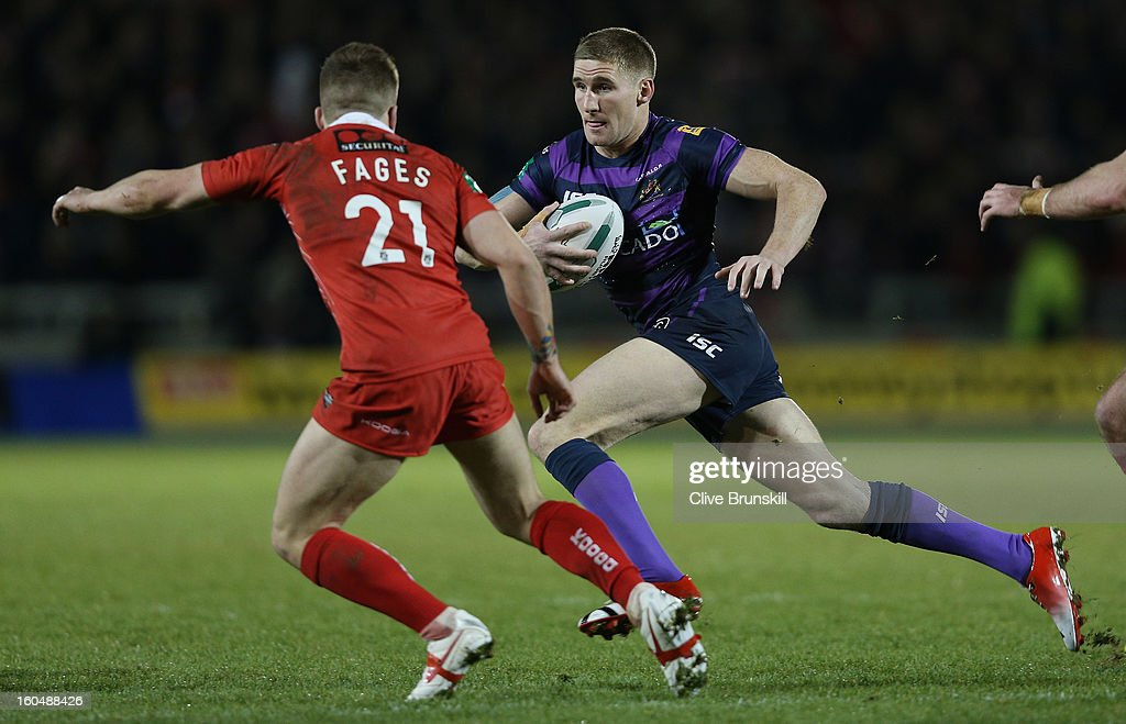 Sam Tomkins of Wigan Warriors attempts to move past Theo Fages of Salford City Reds during the Super League match between Salford City Reds and Wigan Warriors at Salford City Stadium on February 1, 2013 in Salford, England.