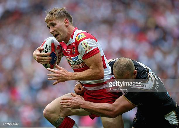 Sam Tomkins of Wigan Warriors is tackled by Daniel Holdsworth of Hull FC during the Tetley's Challenge Cup Final between Wigan Warriors and Hull FC...