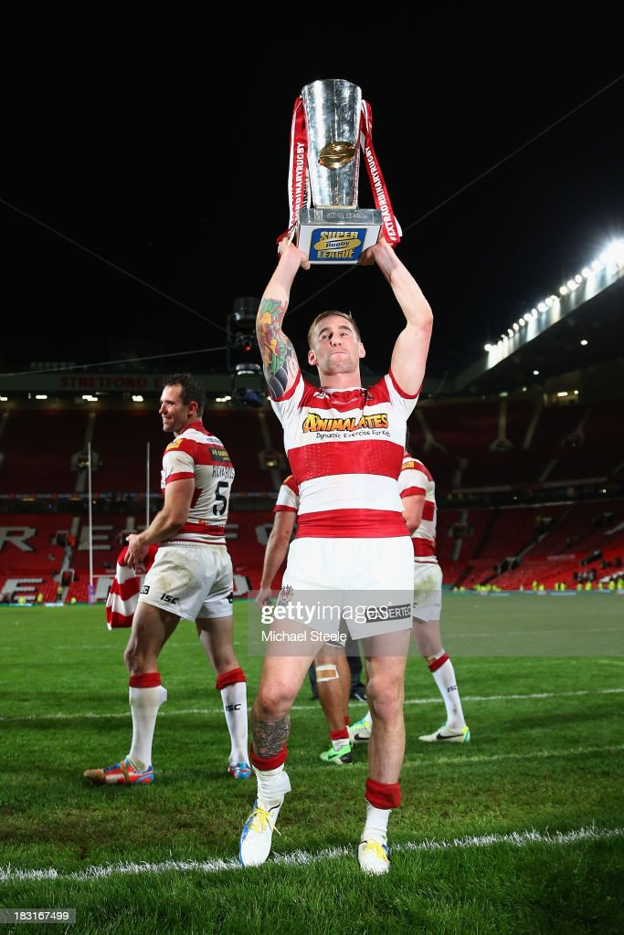 Sam Tomkins of Wigan Warriors lifts the winners trophy after his sides 3016 victory during the Super League Grand Final between Warrington Wolves and...