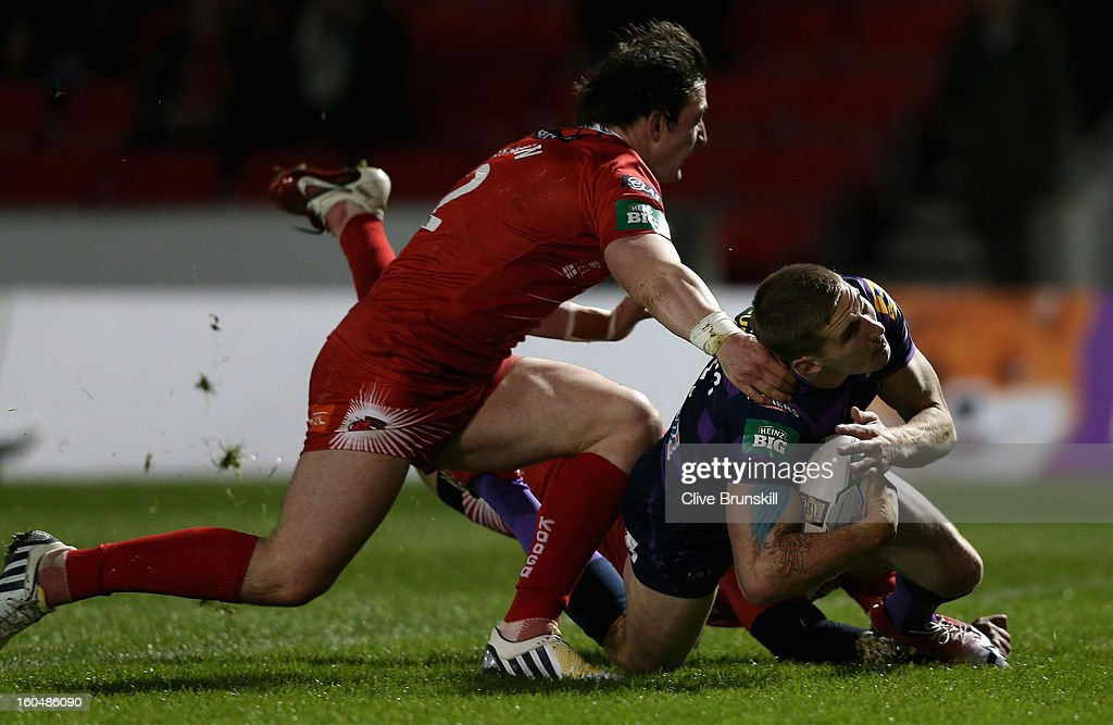 Sam Tomkins of Wigan Warriors scores the first try during the Super League match between Salford City Reds and Wigan Warriors at Salford City Stadium on February 1, 2013 in Salford, England.