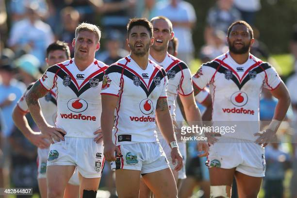 Sam Tomkins Shaun Johnson Simon Mannering and Manu Vatuvei of the Warriors look dejected after a Sharks try during the round five NRL match between...