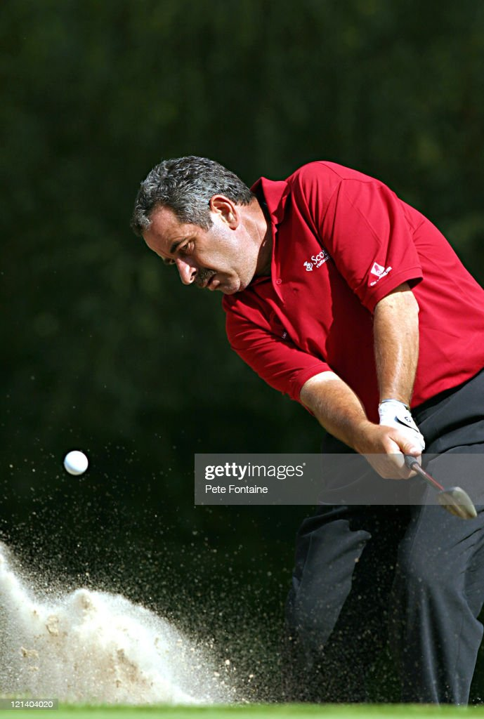 <a gi-track='captionPersonalityLinkClicked' href=/galleries/search?phrase=Sam+Torrance&family=editorial&specificpeople=204630 ng-click='$event.stopPropagation()'>Sam Torrance</a> blasts out of the greenside bunker on the 16th hole during the first round of the Travis Perkins Senior Masters at the Wentworth Golf Club. August 13, 2004