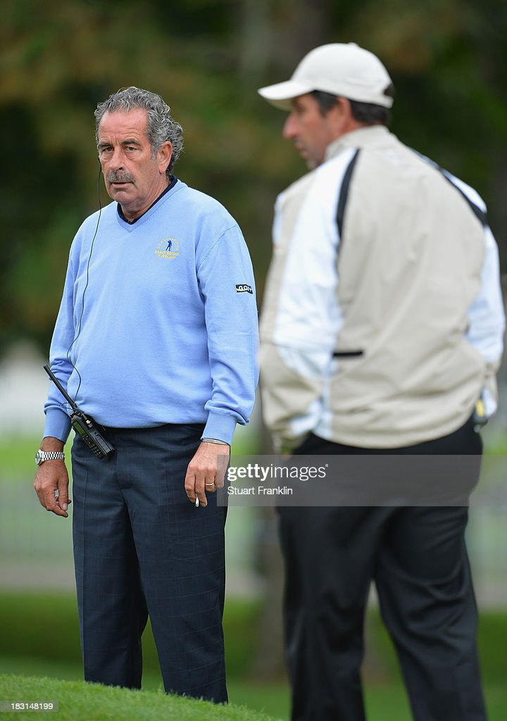 <a gi-track='captionPersonalityLinkClicked' href=/galleries/search?phrase=Sam+Torrance&family=editorial&specificpeople=204630 ng-click='$event.stopPropagation()'>Sam Torrance</a>, captain of the Great Britain and Ireland team looks at <a gi-track='captionPersonalityLinkClicked' href=/galleries/search?phrase=Jose+Maria+Olazabal&family=editorial&specificpeople=176521 ng-click='$event.stopPropagation()'>Jose Maria Olazabal</a>, captain of the European team during the third day's morning foursomes at the Seve Trophy at Golf de Saint-Nom-la-Breteche on October 5, 2013 in Paris, France.
