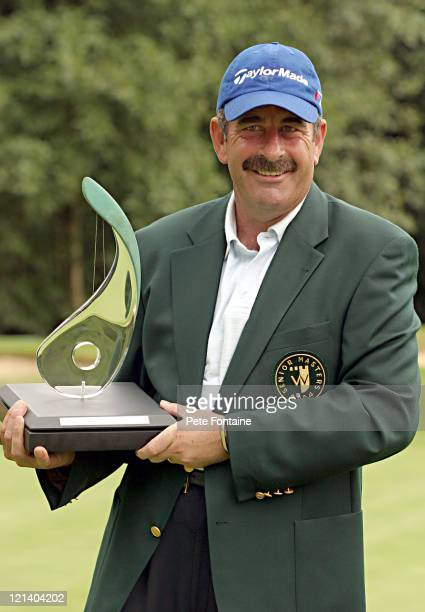 Sam Torrance holds his first European Seniors Tour trophy after the final round of the Travis Perkins Senior Masters at the Wentworth Golf Club