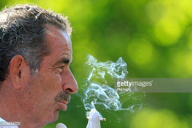 Sam Torrance of Scotland smokes a cigarette during the first round of the Berenberg Bank Masters played at Golf Und LandClub Koln on August 2 2013 in...