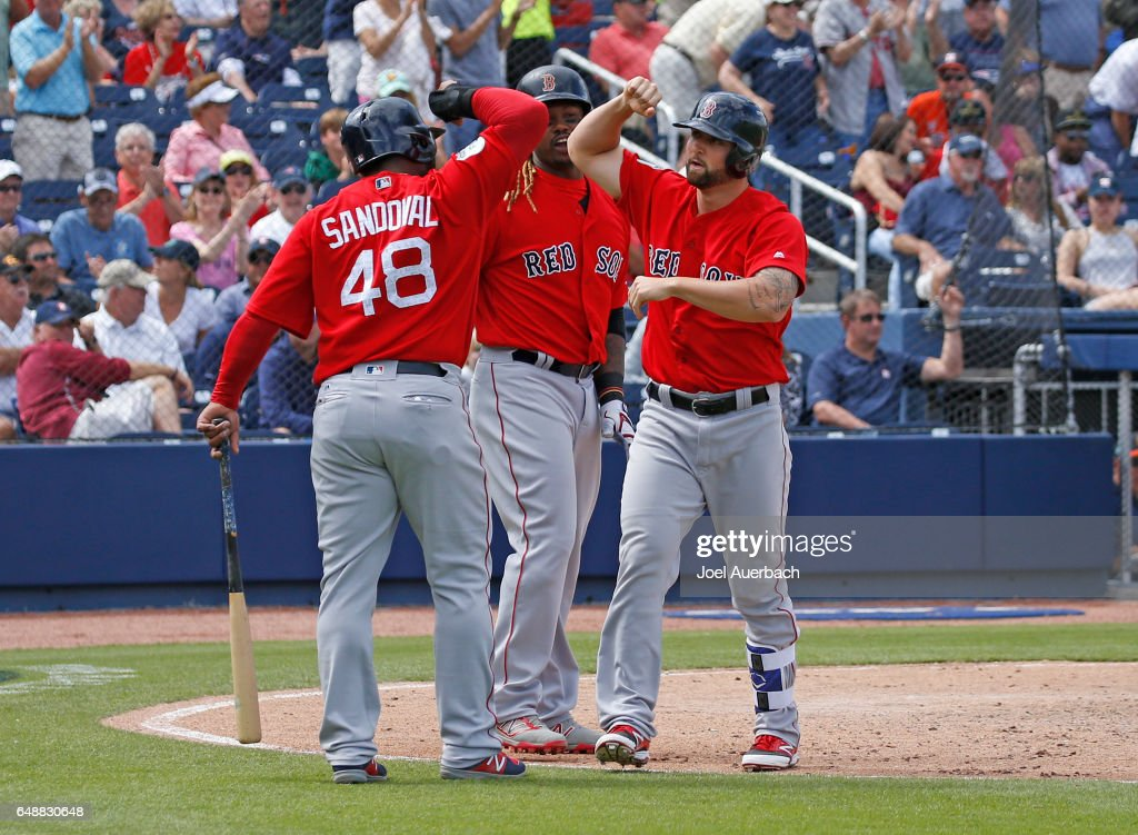 Sam Travis #59 is congratulated by Pablo Sandoval #48 and Hanley Ramirez #13 of the Boston Red Sox after hitting a three run home run against the Houston Astros in the third inning during a spring training game at The Ballpark of the Palm Beaches on March 6, 2017 in West Palm Beach, Florida. The Astros and Red Sox played to a 5-5 tie.
