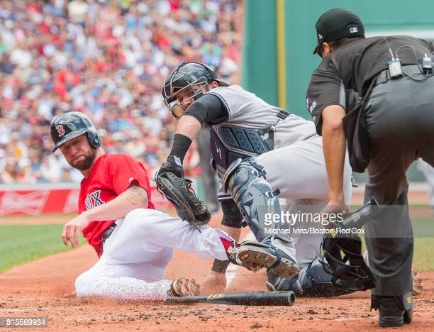 Sam Travis of the Boston Red Sox is tagged out at the plate by Austin Romine of the New York Yankees in the second inning of game one of a...