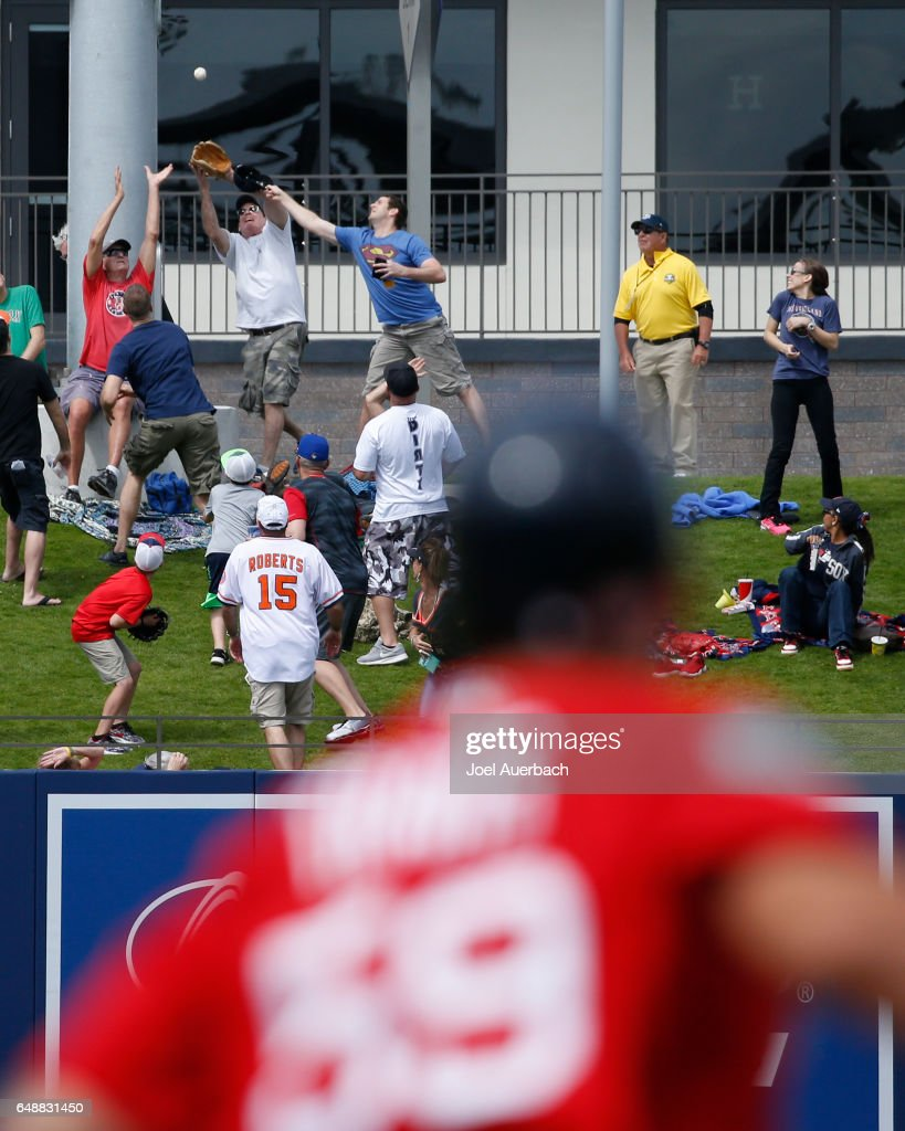Sam Travis #59 of the Boston Red Sox watches fans catch his three run home run ball in left field against the Houston Astros in the third inning during a spring training game at The Ballpark of the Palm Beaches on March 6, 2017 in West Palm Beach, Florida. The Astros and Red Sox played to a 5-5 tie.