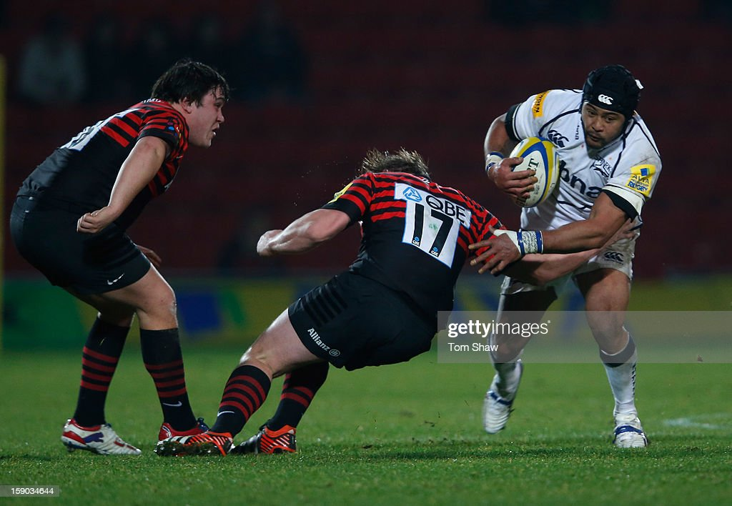 Sam Tuitupou of Sale is tackled during the Aviva Premiership match between Saracens and Sale Sharks at Vicarage Road on January 6, 2013 in Watford, England.