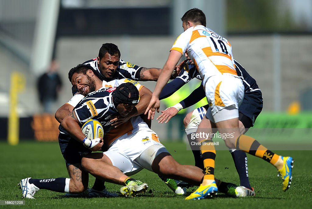 <a gi-track='captionPersonalityLinkClicked' href=/galleries/search?phrase=Sam+Tuitupou&family=editorial&specificpeople=540375 ng-click='$event.stopPropagation()'>Sam Tuitupou</a> of Sale Sharks is tackled by Billy Vunipola of London Wasps during the Aviva Premiership match between Sale Sharks and London Wasps at the Salford City Stadium on May 04, 2013 in Salford, England.